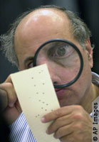 Looking for hanging chad, 2000 Presidential election.jpg