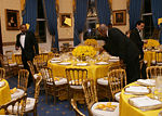 White House butlers place the finishing touches on table settings and decorations, Thursday evening, March 23, 2006 in the Blue Room of the White House, for a Social Dinner hosted by President George W. Bush and Mrs. Laura Bush in honor of the 300th Birthday of Benjamin Franklin.