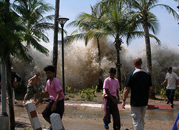 Huge spray between palm trees as people appear to be running away.