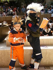 Two children dressed up in ninja costumes.
