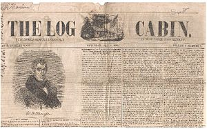 "Picture of a tattered faded newspaper called ""The Log Cabin""."