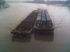 Barge carrying shipping containers.