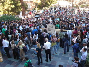 Picture of people assembled outside as a protest.