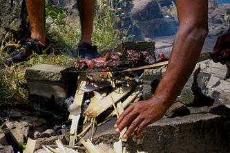 Whale meat being grilled, Semplers Cay, Bequia, St. Vincent & the Grenadines.