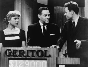 "Picture of three people with the word ""Geritol"" on a podium."