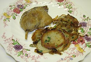 Lyonnaise potatoes served with Confit of duck