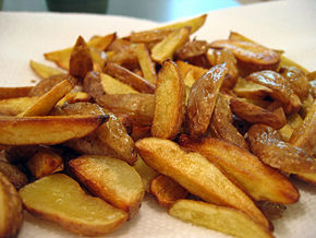 Wedge-cut fries are prepared from small, whole, unpeeled potatoes cut lengthways into quarters or sixths to form the wedges. As can be seen in this photo, the wedges need not be uniform.  Wedge-cut fries are often prepared through oven-fry methods to produce a dish lower in fat.