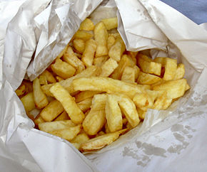 "Chips wrapped in paper, as customarily served in the United Kingdom.  Potatoes used to prepare chips are sliced thicker than many french fry varieties, setting them apart from ""french fries"" in the minds of many Brits."