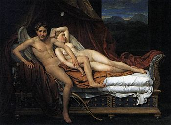 A man and a woman in a bed.